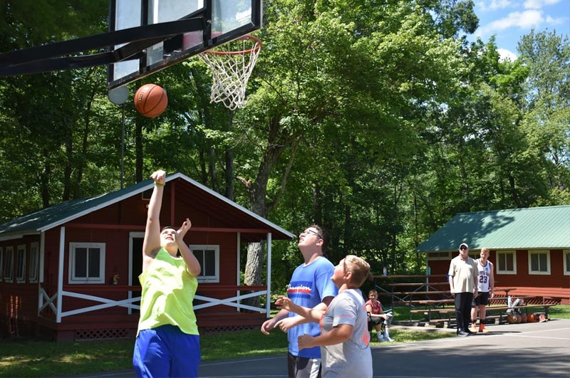 Boys playing basketball during at the best summer weight loss camp, located in the Poconos