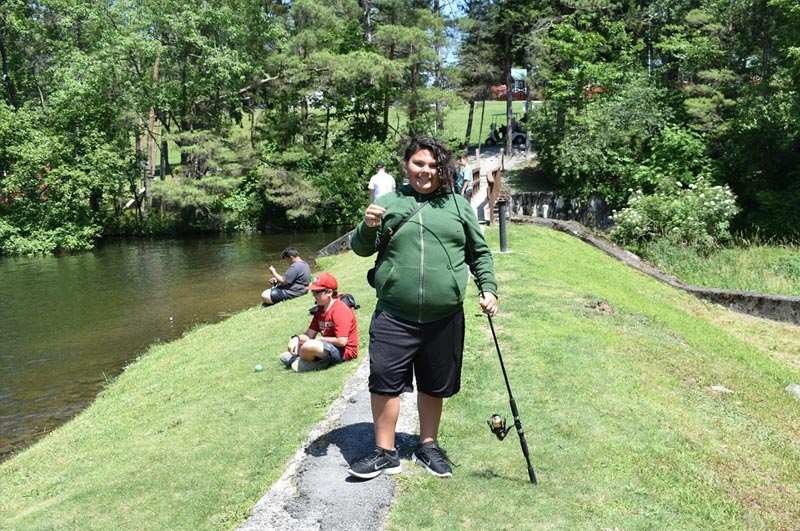 Fishing with camp friends at weight loss summer camp in the Pocono Mountains
