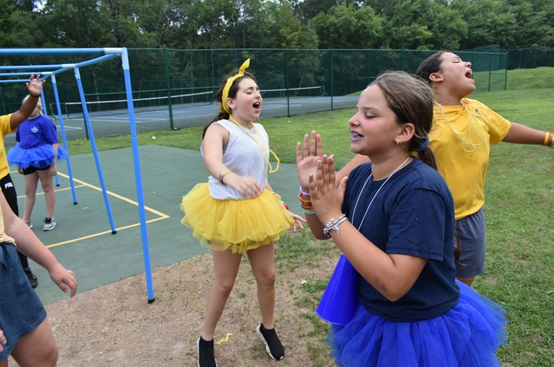 Girls enjoying color war at summer weight loss camp where campers get fit and have fun in a traditional camp setting