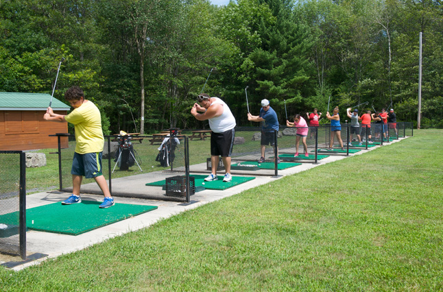 Campers enjoy our golf driving range at our lakefront summer wellness camp; children, teens and adults love Camp Pocono Trails