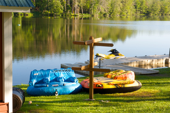 Campers get out on the private lake at Camp Pocono Trails and enjoy water sports like monster tubing, boating and more