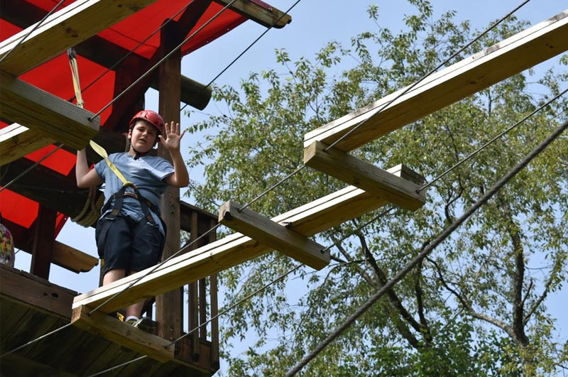 Kids and teens love the ropes course with climbing wall and zip line at the world's greatest summer wellness camp