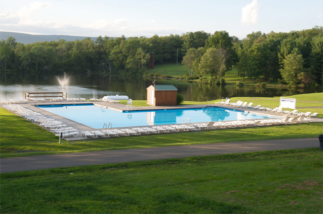 Pooltime fun at Camp Pocono Trails by Tony Sparber here campers enjoy two lakeside pools in the mountains