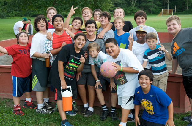 Boys gather friends for a game of gaga ball at the best summer fitness camp, located in the Pocono Mountains