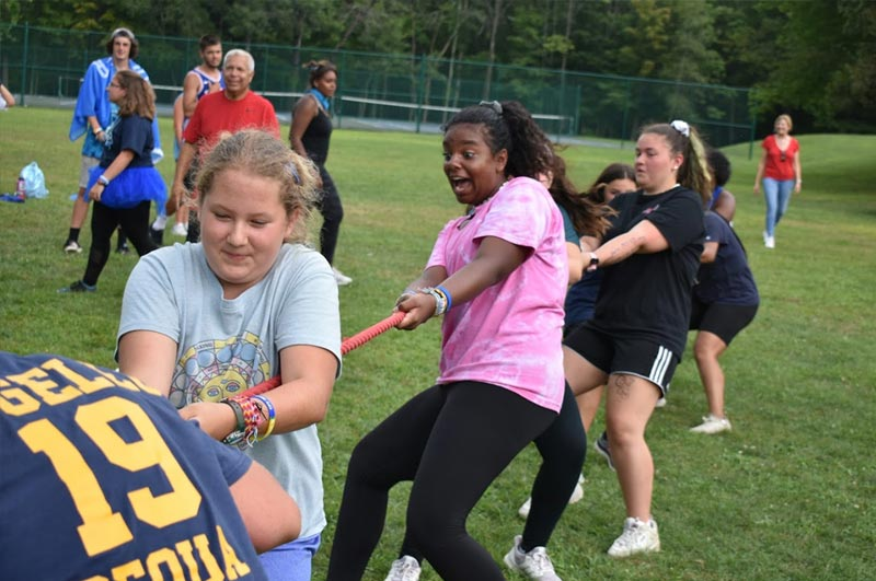 Girls playing tug of war at world famous Camp Pocono Trails for kids and teens