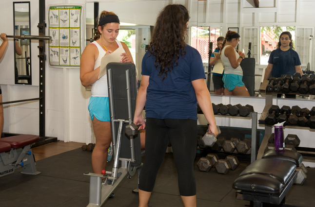 Lifting weight to gain muscle at the best summer weight loss camp, Camp Pocono Trails